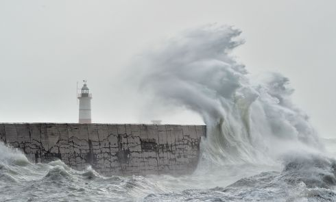 TAKE COVER: Waves crash over Newhaven harbour wall on the south coast of England as Storm Brian hits the country. Photograph: Glyn Kirk/AFP/Getty Images