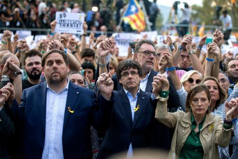 BIG DECISIONS: Catalan regional president Carles Puigdemont, regional vice-president Oriol Junqueras (left), and speaker of the Catalan Parliament Carme Forcadell, attend the protest called against the imprisonment of Catalan pro-independet leaders in Barcelona, hours after the Spanish prime minister announced the central Government would asume the competence to disolve the Catalan regional parliament. Photograph: Quique Garcia/EPA