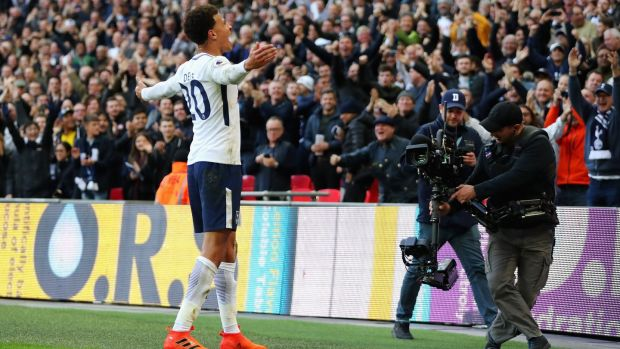 Dele Alli celebrates putting Tottenham Hotspur 3-1 up against Liverpool. Photograph: Richard Heathcote/Getty