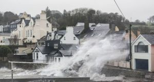 Ophelia waves crash into the town of Summercove near Kinsale, Co Cork. Photograph: John Allen
