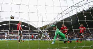 Aaron Mooy scores Huddersfield's first against Manchester United. Photograph: Matthew Lewis/Getty Images