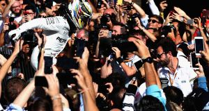 Lewis Hamilton celebrates in Parc Ferme during the United States Formula One Grand Prix. Photograph: Mark Thompson/Getty Images