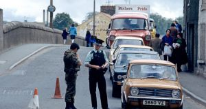 An  RUC and British army vehicle checkpoint  during The Troubles. Photograph: Alain Le Garsmeur/Getty Images