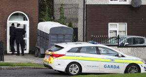 Gardaí at the property in Brookview Lawns, in the Jobstown area of Dublin. Photograph: Niall Carson/PA Wire