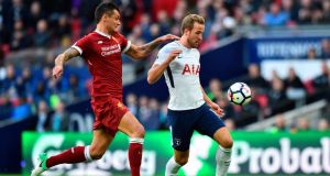 Dejan Lovren endured a torrid afternoon against Harry Kane and Tottenham. Photograph: Glyn Kirk/AFP
