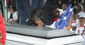 Myeshia Johnson she kisses the casket of her husband army Sgt La David Johnson during his burial service at the Memorial Gardens East cemetery in Hollywood, Florida. Photograph: Gaston de Cardenas/AFP/Getty Images