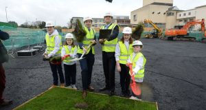 Leo Varadkar and Simon Harris with children from the Youth Advisory Council as they urned the sod at a new paediatric outpatients and urgent care centre at Connolly Hospital Blanchardstown. Photograph: Dara Mac Dónaill