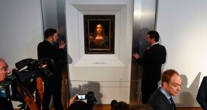 Security personnel stand next to Leonardo da Vinci's 'Salvator Mundi' after it was unveiled at Christie's in New York on October 10th. Photograph: Jewel Samad/AFP/Getty Images