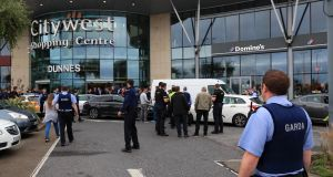 Armed gardaí arrest a man at Citywest Shopping Centre after a chase throught Tallaght. Photograph: Colin Keegan/Collins Dublin