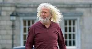 Mick Wallace: Mr Wallace and his son were in court for the opening on Monday of the hearing of the Companies Act application.  Photograph: Eric Luke