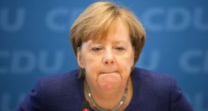 Angela Merkel: Her previously unquestioned leadership is now under fire. Photograph: Omer Messinger