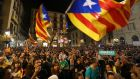 People wave Catalan independence flags at a demonstration in Barcelona on Saturday. Photograph:  Sean Gallup/Getty Images
