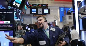 US stocks traded in a narrow range, with losses in industrial shares led by General Electric offsetting gains elsewhere. Photograph: Spencer Platt/Getty Images