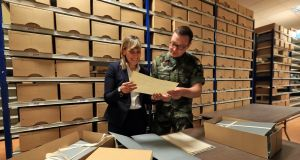Senior archivist Cécile Gordon, project manager of the Military Service Pensions Collection, and Capt Daniel Ayiotis in the Military Archives at Cathal Brugha Barracks, Dublin. Photograph: Colin Keegan, Collins