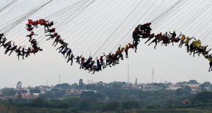 BUNGEE JUMPERS: Some of the 245 people attempting to set a new world record for group bungee jumping, from a 30m-high bridge in Hortolandia, Brazil. Photograph: Paulo Whitaker/Reuters