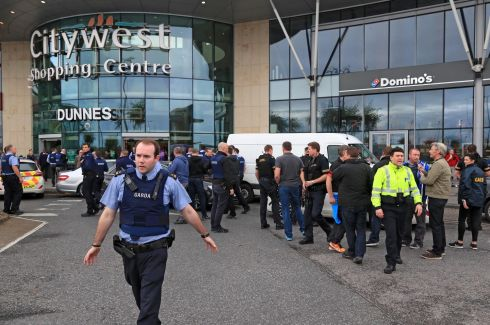 END OF THE ROAD: Armed gardaí at Citywest Shopping Centre in Dublin, where they arrested a suspect after an eight-hour manhunt; he had run through the centre with a loaded machine gun. Photograph: Colin Keegan/Collins