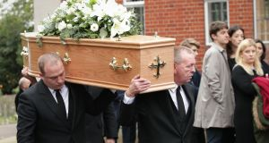 The coffin of Sean Hughes is carried into Islington and Camden Cemetery in London. Photograph: Yui Mok/PA Wire