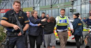 Armed gardaí arrest a man at Citywest Shopping Centre in Dublin on Monday. Photograph: Colin Keegan/Collins