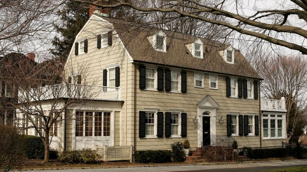 The rich history and beauty of the Amityville horror house are overshadowed by the story of George and Kathy Lutz, the previous residents of 112 Ocean Avenue. Photograph: by Paul Hawthorne/Getty Images