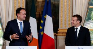 French President Emmanuel Macron, (right), listens to Taoiseach Leo Varadkar during a joint  press conference at the Elysee Palace in Paris on  Tuesday.  Photograph: Reuters
