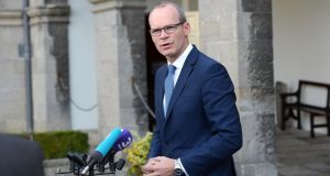 Simon Coveney  told the Dáil that  different banks are behaving differently in terms of the pace of their co-operation with the Central Bank. File photograph: Dara Mac Donaill