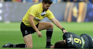 Referee Ben Whitehouse helps Morgan Parra of Clermont at Stade Marcel- Michelin. Photograph: David Rogers/Getty Images