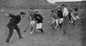 Ireland's lost leader: Michael Collins throws in the ball at Croke Park in 1921. Photograph: Hogan/Hulton/Getty