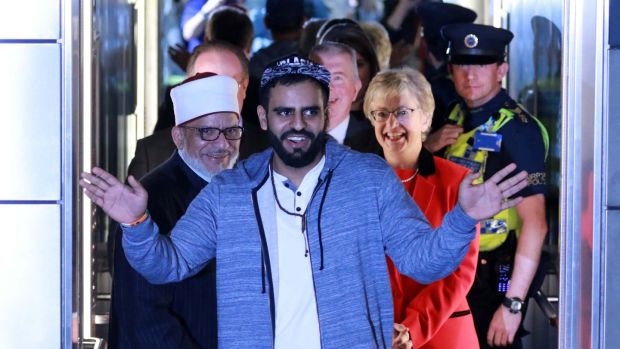 Ibrahim Halawa: the lift doors open on the freed Irishman, his father and Minister for Youth Affairs Katherine Zappone. Photograph: Nick Bradshaw