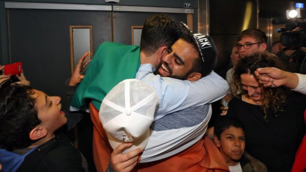Ibrahim Halawa: the first of many bear hugs. Photograph: Colin Keegan/Collins