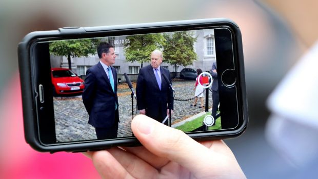 Apple back taxes: Paschal Donohoe with then minister for finance Michael Noonan when they announced the government's decision to appeal the European Commission's €13 billion ruling. Photograph: Paul Faith/AFP/Getty