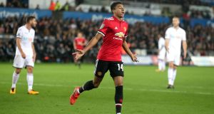 Manchester United's Jesse Lingard celebrates his first goal at the Liberty Stadium. Photograph: PA