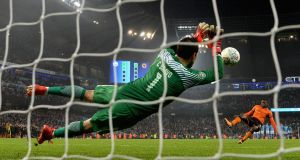 Claudio Bravo of Manchester City saves a penalty at the Etihad Stadium. Photograph:  Gareth Copley/Getty Images