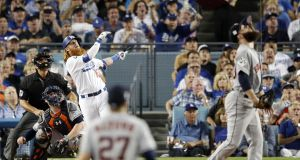 Los Angeles Dodgers Justin Turner follows through on a two-run home run off Houston Astros pitcher Dallas Keuchel in the bottom of the sixth inning of game one of the Major League Baseball (MLB) World Series at Dodger Stadium in Los Angeles. Photo: Adam Davis/EPA