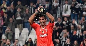 Juventus' goalkeeper Gianluigi Buffon celebrates after their Champions League win over Sporting Lisbon. Photo: Miguel Medina/Getty Images