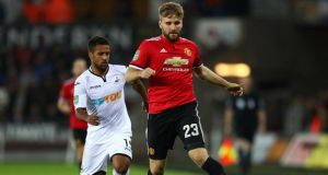 Wayne Routledge of Swansea City and Luke Shaw of Manchester United battle for possession during their Carabao Cup fourth round clash. Photo: Michael Steele/Getty Images