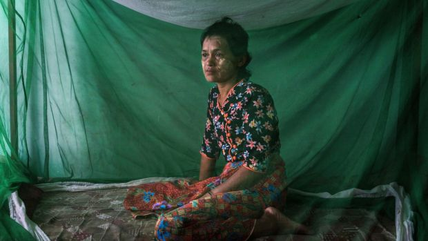 Daw Soe Chay poses for a portrait in Sittwe, Myanmar, on October 2nd. Soe Chay, an ethnic Rakhine Buddhist from Myebon Township, was beaten and publicly shamed after her husband delivered aid to Rohingya Muslims in their camp in Sittwe. Photograph: Adam Dean/The New York Times
