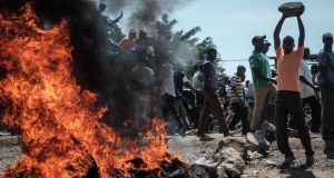 Supporters of  opposition leader  Raila Odinga barricade roads and burn tyres as they demonstrate in the streets in Kisumu, Kenya on Wednesday. Photograph: Yasuyoshi Chiba/AFP/Getty Images