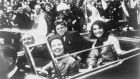 JFK assassination: President Kennedy, Jacqueline Kennedy and (left) Governor John Connally in the presidential motorcade in Dallas just before Kennedy was shot. Photograph: Victor Hugo King/Library of Congress