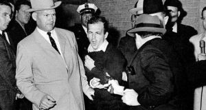 JFK assassination: Lee Harvey Oswald grimaces as he is shot dead by Jack Ruby. Photograph: Bob Jackson/Dallas Times-Herald/AP