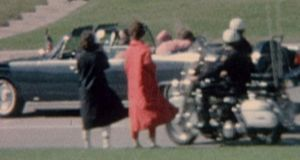 JFK assassination: Jacqueline Kennedy cradles her husband seconds after he was fatally shot. Photograph: AP