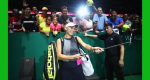 Caroline Wozniacki  takes a selfie with fans as she celebrates victory in her singles match against Simona Halep  at  the BNP Paribas WTA Finals in Singapore.  Photograph:  Clive Brunskill/Getty Images