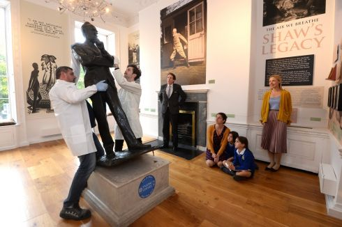 PYGMALION: Wayne Scully (Irish Arts Services) and David Meaney (designer) adjusting the George Bernard Shaw statue in the Little Museum of Dublin watched by Ruth Hegarty (Royal Irish Academy) with her daughters Isoult and Elana Murphy. Photograph: Cyril Byrne/The Irish Times
