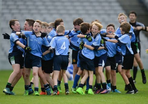 CELEBRATE TOGETHER: Donabate Portrane Educate Together players celebrate at the final whistle of their victory over St Patrick's NS Glencullen during day one of the Allianz Cumann na mBunscol finals at Croke Park in Dublin. Photograph: Cody Glenn/Sportsfile