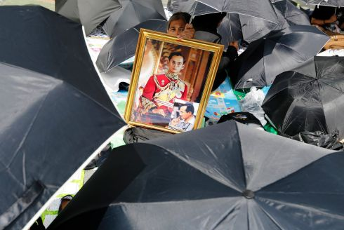 ICON: A Thai mourner holds a portrait of the late Thai King Bhumibol Adulyadej as he and others gather to attend the Royal Cremation ceremony in Bangkok. Millions of Thais will bid their final farewell to late premier after he died at the age of 88 in Siriraj hospital after 70 years on the throne. Photograph: Narong Sangkak/EPA