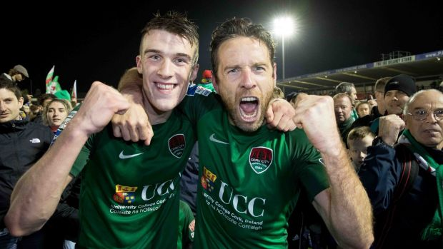 Cork City's Ryan Delaney and Alan Bennett celebrate winning the league with supporters. Photograph: Morgan Treacy/Inpho