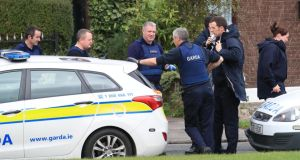 Gardaí at a house on the Brookview Estate, Tallaght on Monday as a manhunt began. Photograph: Colin Keegan/Collins Dublin