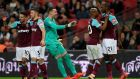 Angelo Ogbonna celebrates with his West Ham teammates after scoring his team's third goal. Photograph: Stu Forster/Getty Images