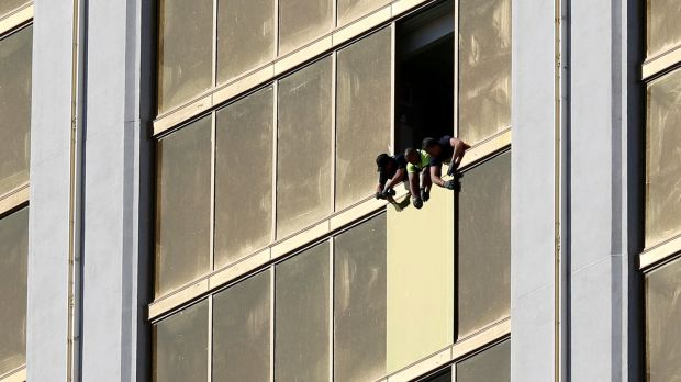 Workers board up a broken window at the Mandalay Bay hotel, where Stephen Paddock conducted his mass shooting on October 6th. Photograph: Chris Wattie/Reuters