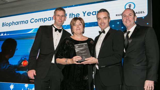 Adam O'Sullivan, Director of Pharma and Healthcare, Kuehne + Nagel Ireland presents the Biopharma Company of the Year award to the Amgen Technology Ireland