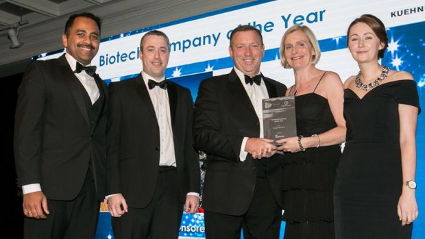 Peter McNamara, Managing Director, Micro-Bio Ireland presents the Biotech Company of the Year award to the Sanofi Waterford team